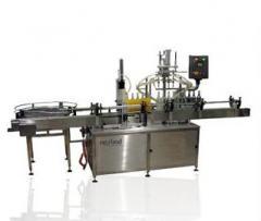 מכונה אוטומטית למילוי ופיקוק בקבוקים  Tornado linear